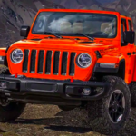2019 Jeep Wrangler in a bright red-orange tone.
