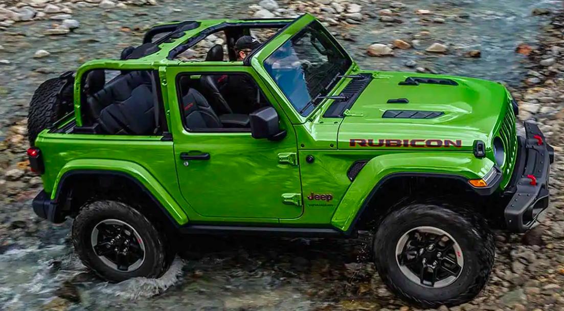2019 Jeep Wrangler driving through a stream