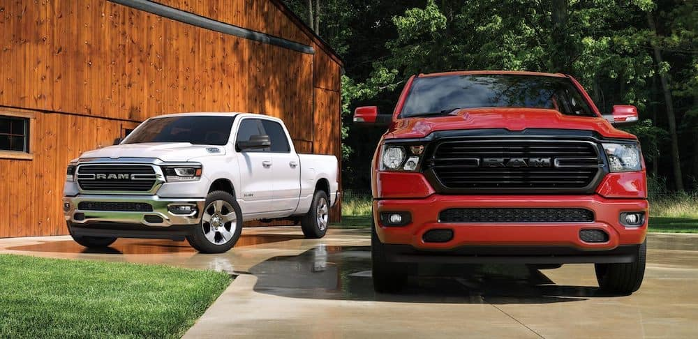 Two new 2020 RAM 1500 models parked side by side