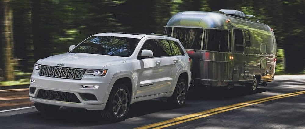A 2020 Jeep Grand Cherokee towing an Airstream camper
