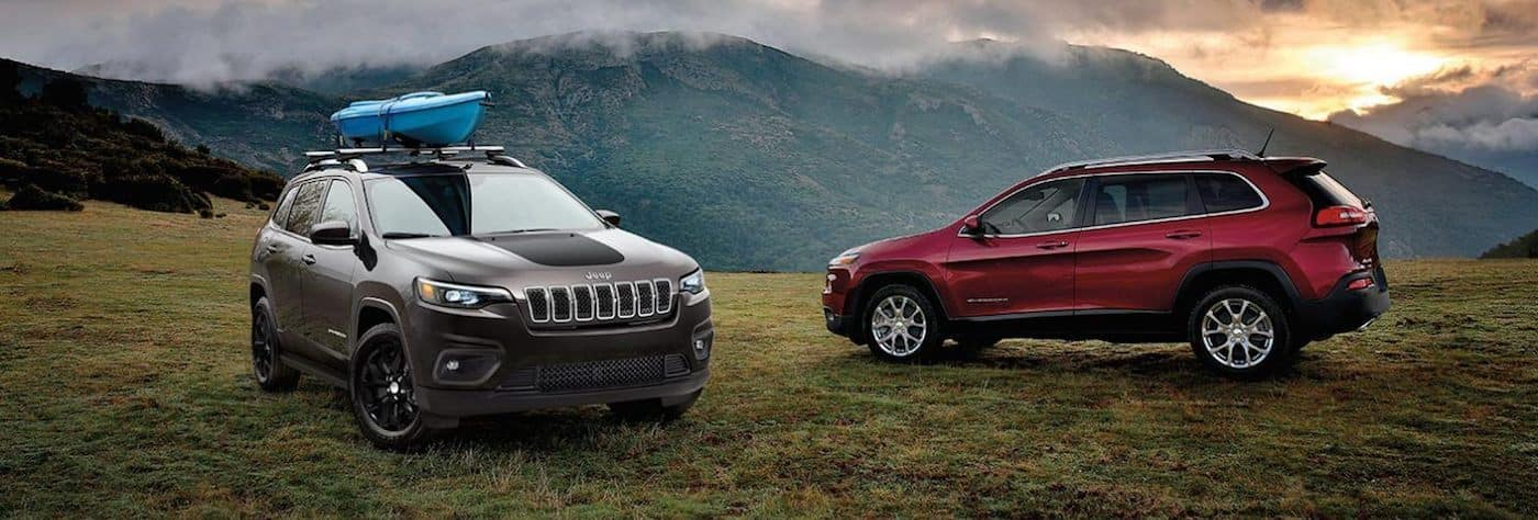 Two new 2020 Jeep Cherokee models parked on a mountain