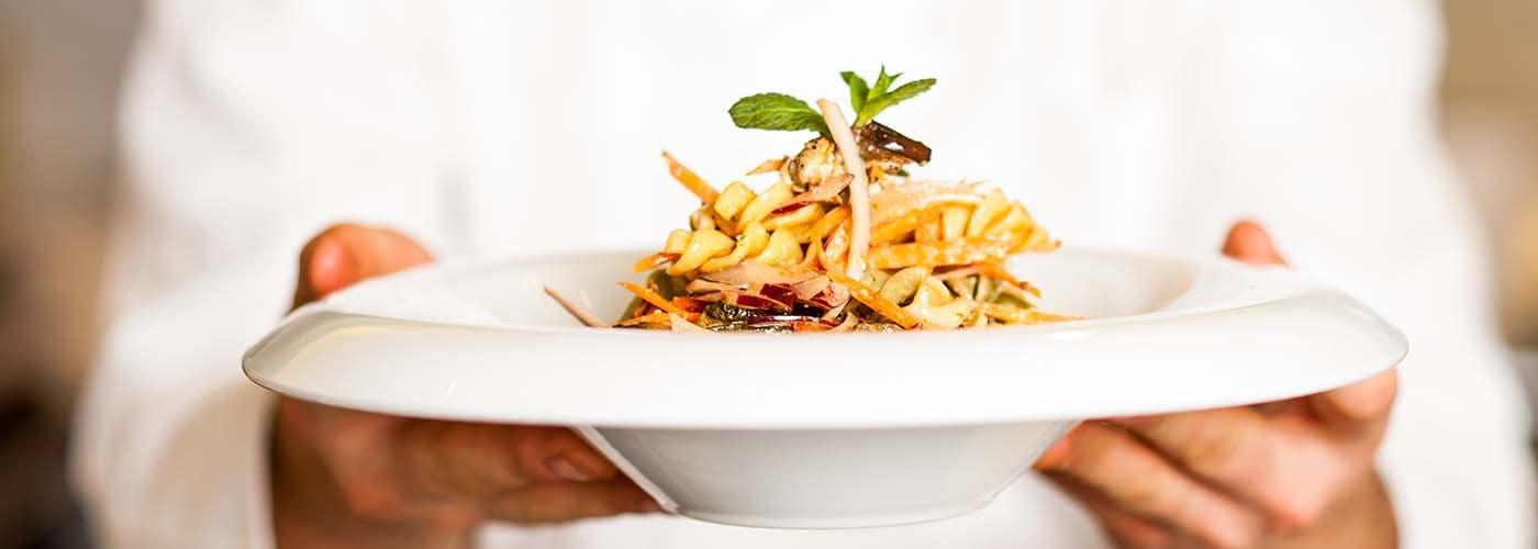 chef presenting a pasta dish