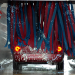 red car going through car wash