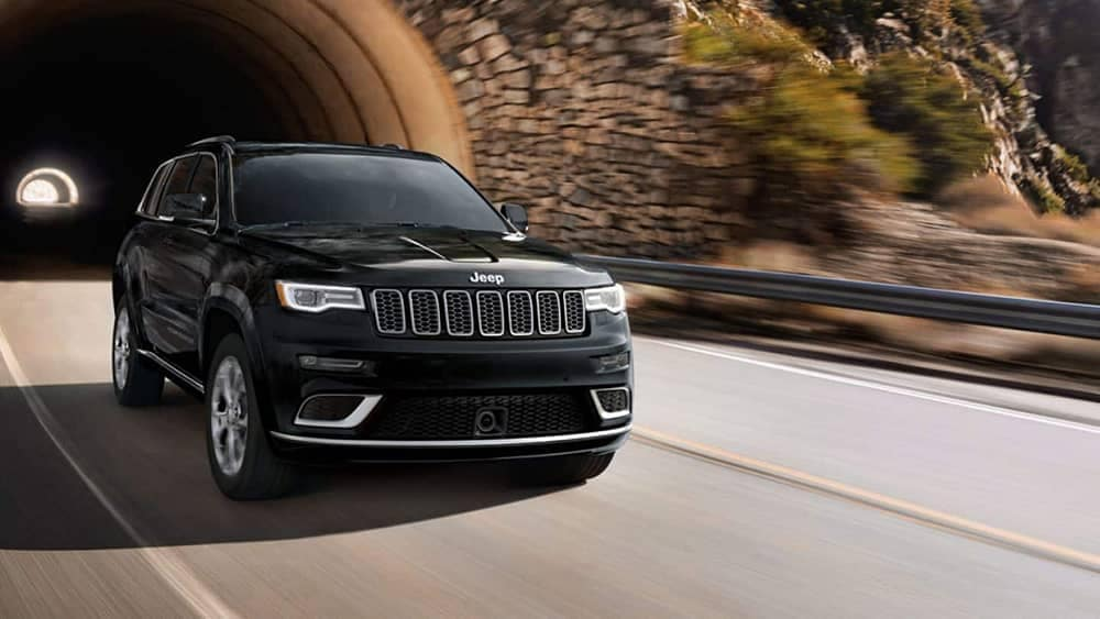 2019 Jeep Grand Cherokee driving out of tunnel