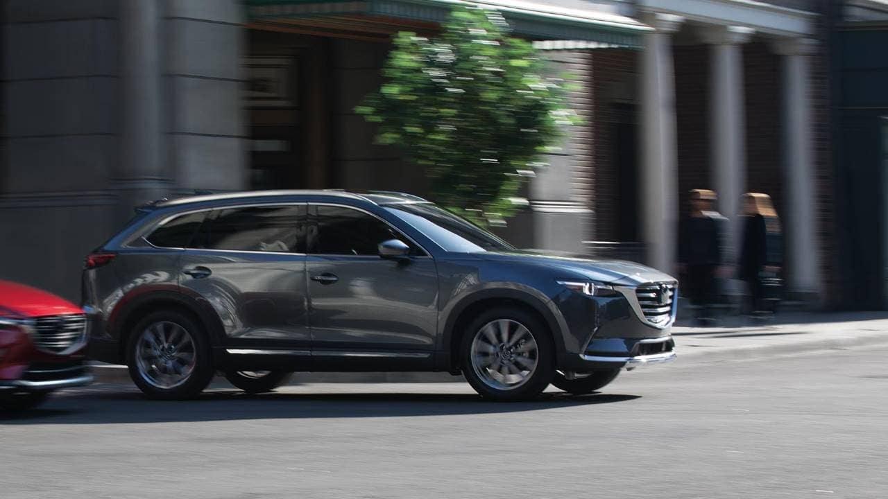 2019 Mazda CX-9 speeding through the city