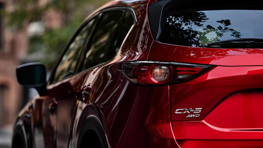 bumper of red 2020 Mazda CX-5 with AWD badging