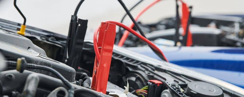 Jumper Cables Charging Car Battery