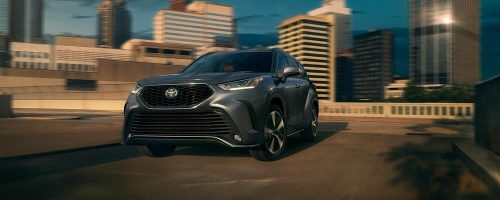 2021 Toyota Highlander driving away from the city
