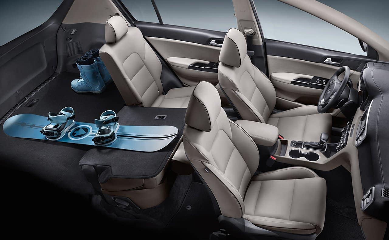 2019 Kia Sportage interior in tan leather with back seat folded down