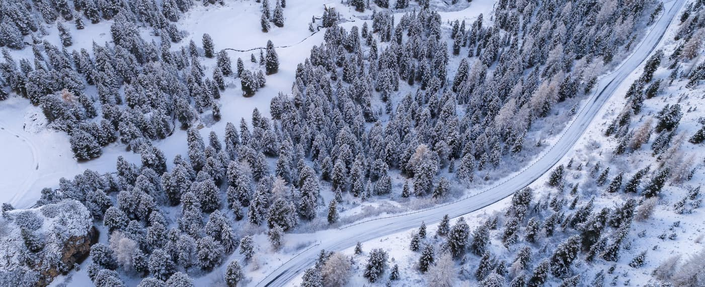 snowy road in winter aerial view