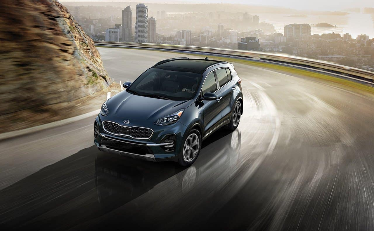 2019 Kia Sportage driving down curved road