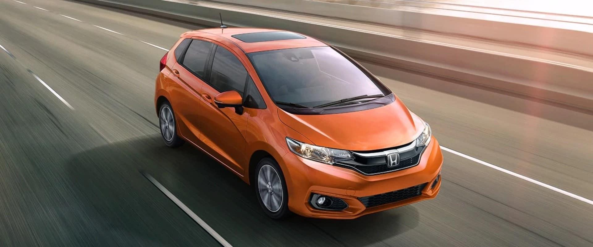 Honda_Fit_Orange_Driving