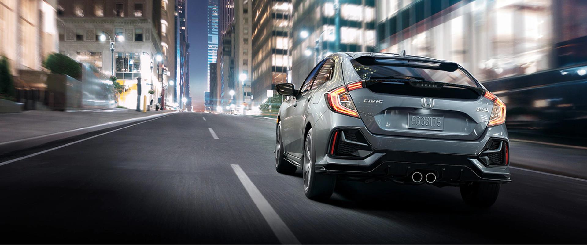 Honda_Civic_Hatchback_Driving_Rear_View