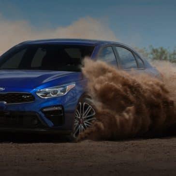 Kia_Forte_Blue_GT_Driving_On_Dirt
