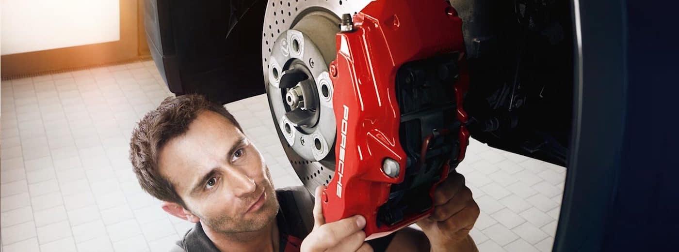 Man adjusting Porsche wheels