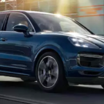 2020 porsche cayenne blue exterior driving down road