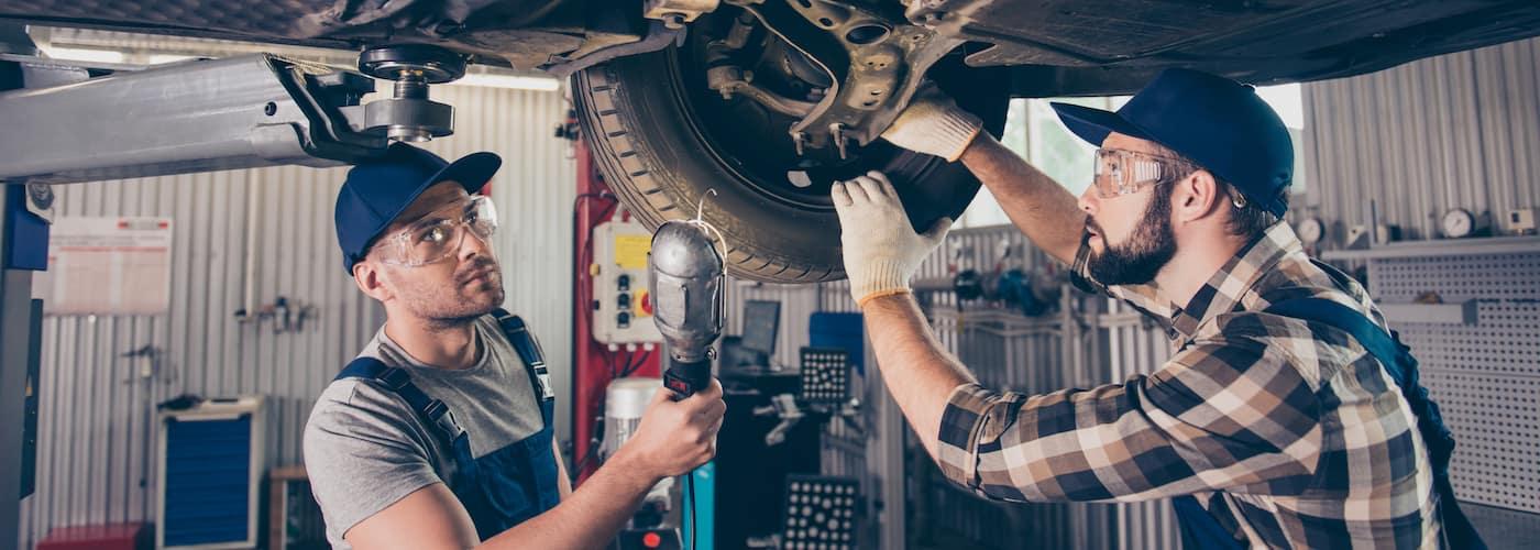 mechanic checking brakes close up