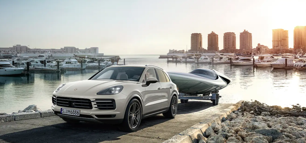2020 porsche cayenne white exterior towing boat out of water