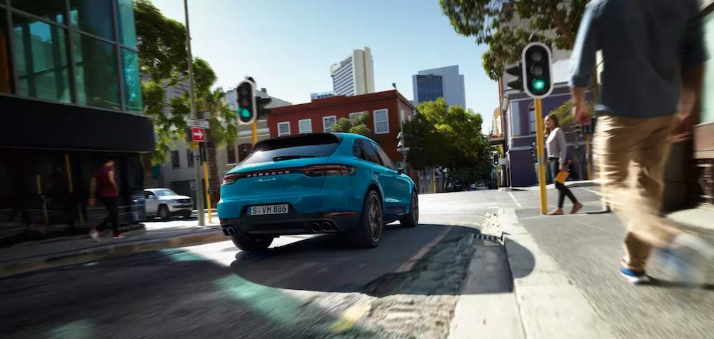 2020 porsche macan blue exterior driving down road