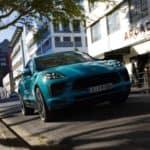 2021 porsche macan blue exterior driving down road