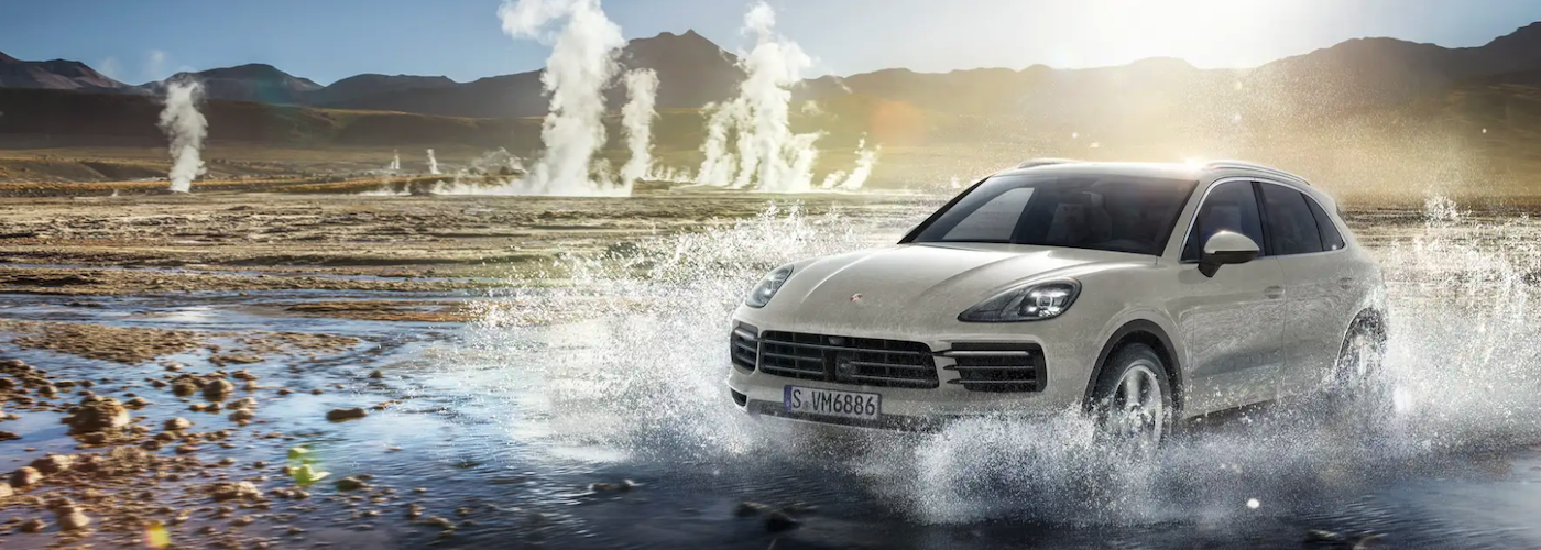 2021 porsche cayenne white exterior driving through water and hot springs