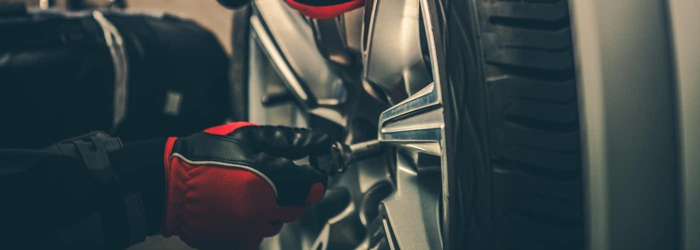mechanic rotating tire close up