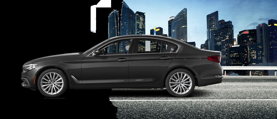 Black BMW 5 Series Driving at Night
