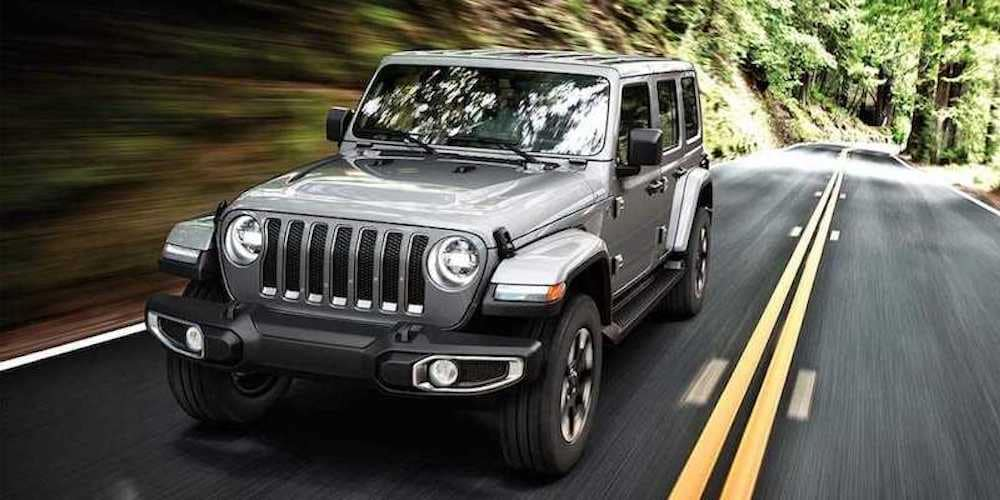 2019 wrangler on road in woods