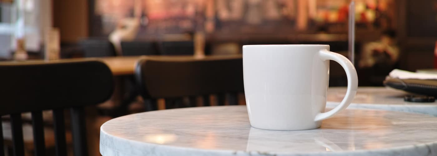 coffee mug on table at coffee shop