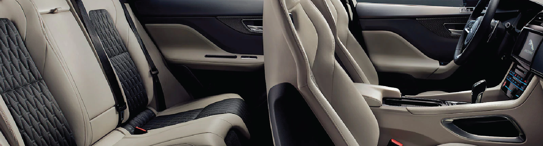 IMAGE OF JAGUAR F-PACE INTERIOR IN BLACK AND BEIGE.