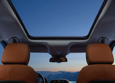 INTERNAL VIEW OF THE 2020 JAGUAR F-PACE MOON ROOF FROM THE BACK CABIN OF THE VEHICLE.