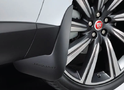 IMAGE OF JAGUAR F-PACE TIRE AND MUD FLAP.