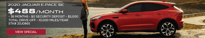 2020 JAGUAR E-PACE SE_$488 PER MONTH_36 MONTH LEASE TERM_$0 SECURITY DEPOSIT_$5,000 TOTAL DRIVE OFF_10,000 MILES PER YEAR_STOCK NUMBER 20J0865_VIEW SPECIAL_OFFER ENDS 1/31/2020_SEE DEALERSHIP FOR COMPLETE DETAILS_RED JAGUAR E-PACE WITH WOMAN STANDING INFRONT OF PARKED VEHICLE OVER LOOKING LAKE