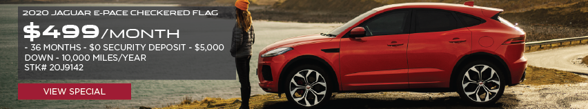 2020 JAGUAR E-PACE CHECKERED FLAG_$499 PER MONTH_36 MONTH LEASE TERM_$0 SECURITY DEPOSIT_$5,000 DOWN_10,000 MILES PER YEAR_STOCK NUMBER 20J9142_VIEW SPECIAL_SEE DEALERSHIP FOR COMPLETE DETAILS_RED JAGUAR E-PACE WITH WOMAN STANDING INFRONT OF PARKED VEHICLE OVER LOOKING LAKE