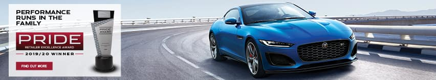 PERFORMANCE RUNS IN THE FAMILY. PRICE RETAILER EXCELLENCE AWARD. 2019 AND 2020 WINNER. FIND OUT MORE BLUE JAGUAR F-TYPE DRIVING DOWN ROAD NEAR OCEAN.