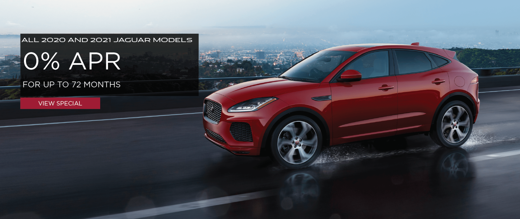 ALL 2020 AND 2021 JAGUAR MODELS. 0% APR FOR UP TO 72 MONTHS. VIEW SPECIAL. RED JAGUAR E-PACE DRIVING DOWN ROAD DURING RAIN STORM.