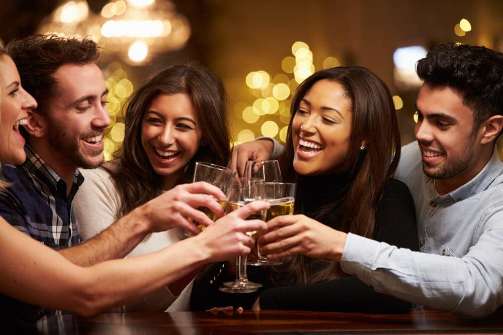 Group Of Friends Enjoying Drinks In Bar
