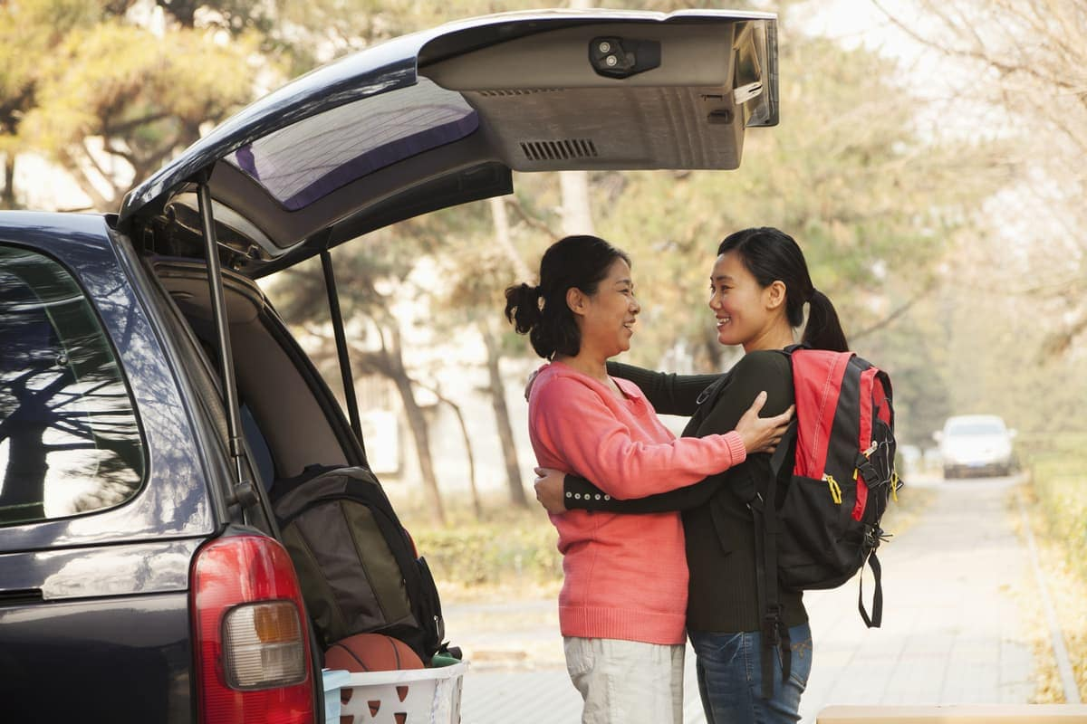 Mother and daughter unpacking car for college