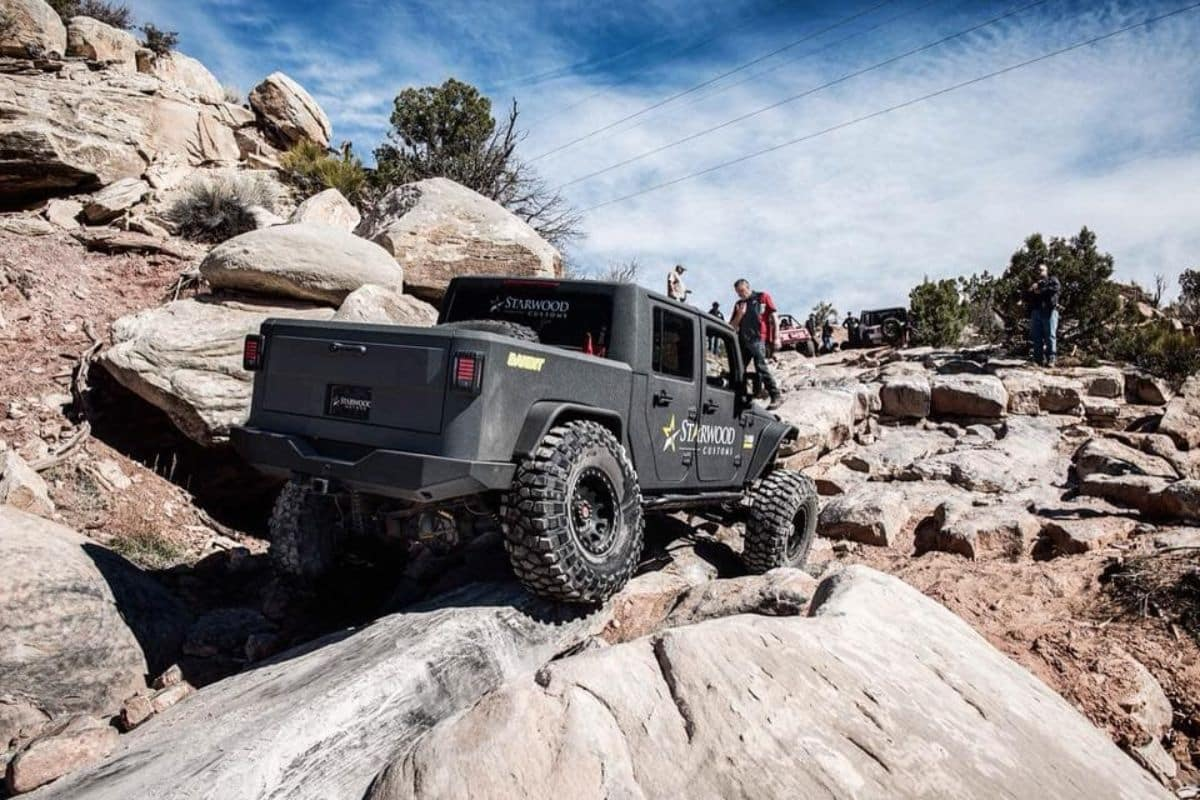 Starwood Motors custom jeep driving on rocky terrain