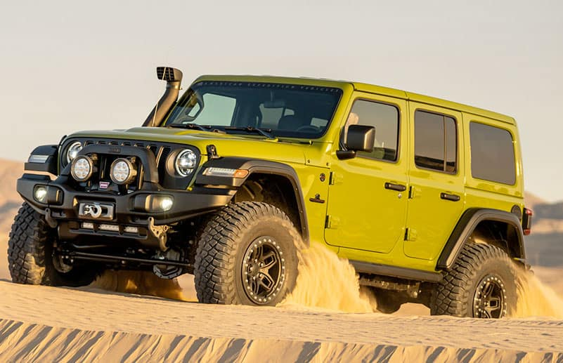 AEV JL Jeep Wrangler driving through sand dune