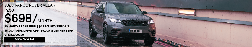 2020 RANGE ROVER VELAR P250_$698 PER MONTH_39 MONTH LEASE TERM_$0 SECURITY DEPOSIT_$6,000 TOTAL DRIVE OFF_10,000 MILES PER YEAR_STOCK NUMBER 20L9238_VIEW SPECIAL_OFFER ENDS 1/31/2020_SEE DEALERSHIP FOR COMPLETE DETAILS_GRAY RANGE ROVER VELAR DRIVING THROUGH CITY