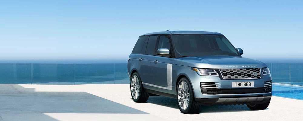 2019 Range Rover in blue parked near ocean
