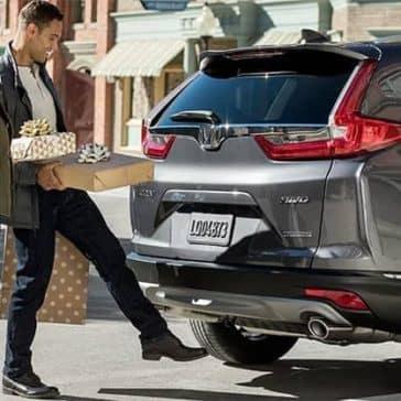 Couple Loading Presents into 2019 Honda CR V Cargo Area