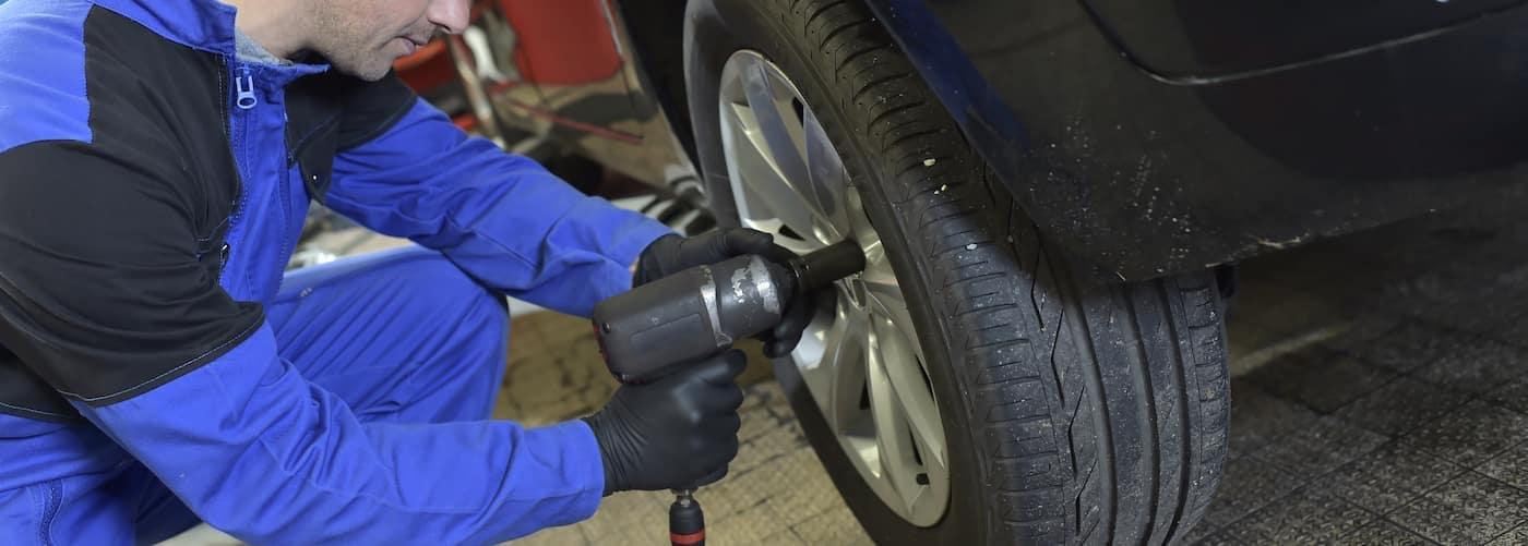 Mechanic rotating a tire