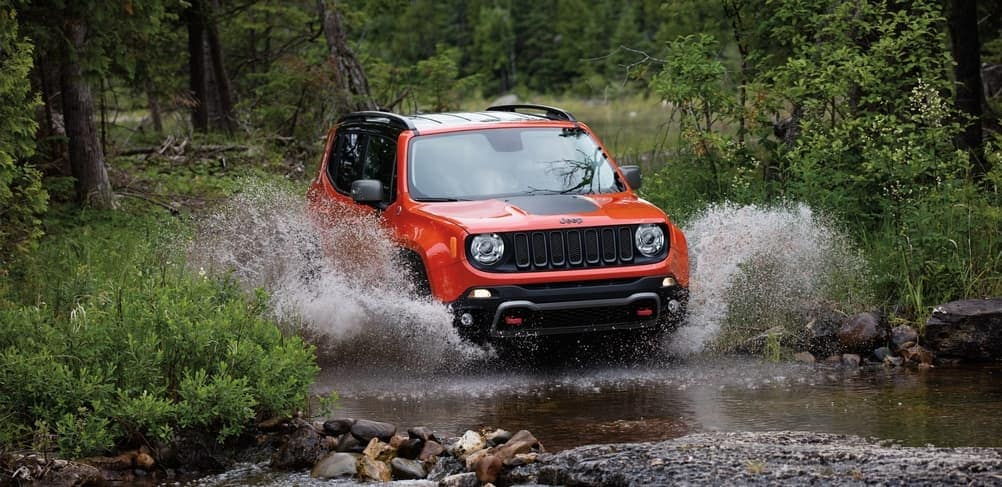 2019 Jeep Renegade driving through large puddle in the woods