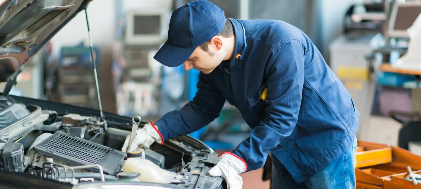 Mechanic inspecting an engine