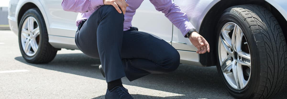 man pointing at mercedes-benz tire