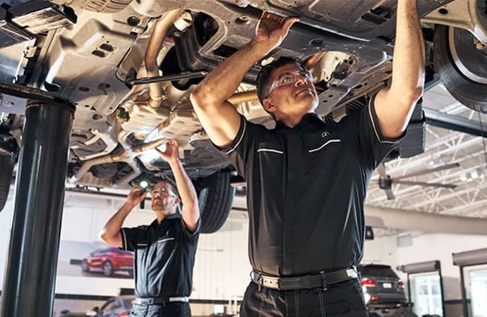 Mercedes-Benz Technicians working on car
