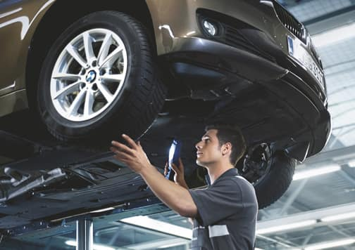 BMW Technician Working on a Vehicle