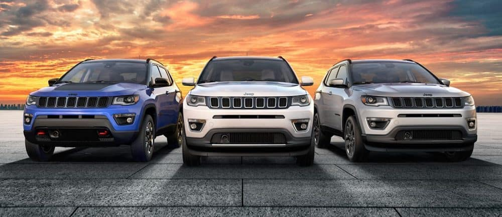Head on view of 3 2020 Jeep Compass models parked side by side